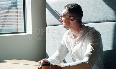 Buy stock photo Shot of a mature businessman looking thoughtfully out of a window in a modern office