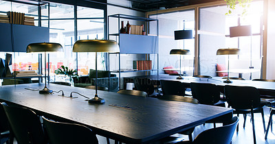Buy stock photo Shot of a table and chairs in a modern office