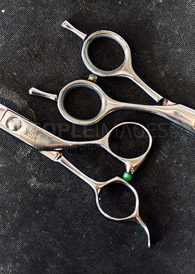 Buy stock photo Still life shot of a set of shear scissors used for trimming hair inside a barbershop