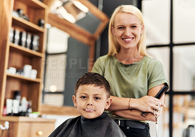 Buy stock photo Portrait of an adorable little boy getting a haircut at a salon