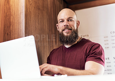 Buy stock photo Portrait of a handsome young barber working at the reception area of his barbershop
