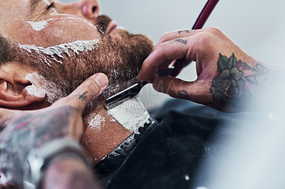 Buy stock photo Cropped shot of an unrecognizable man getting his beard trimmed and lined up at a barbershop