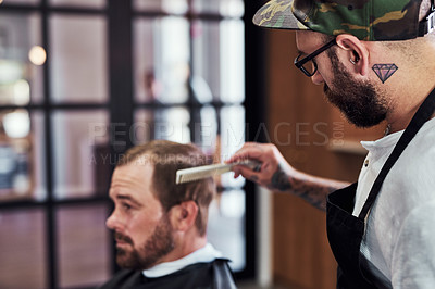 Buy stock photo Cropped shot of a handsome mature man getting a haircut at a barbershop