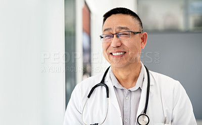 Buy stock photo Cropped shot of a mature male doctor feeling cheerful and confident while working inside a hospital