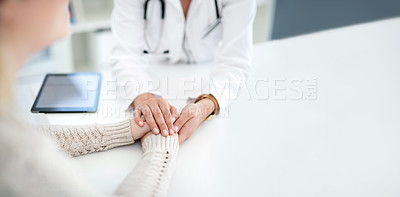 Buy stock photo Closeup shot of an unrecognizable female doctor holding a patient's hand in comfort during a consultation inside her office