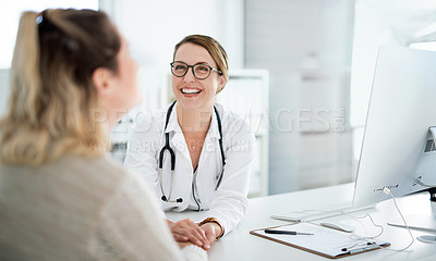 Buy stock photo Cropped shot of a female doctor holding a patient's hand in comfort during a consultation inside her office