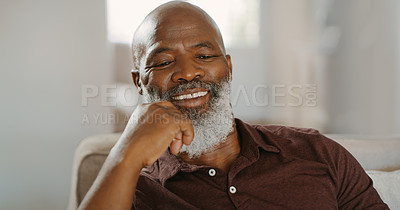 Buy stock photo Cropped shot of a happy senior man sitting alone on his sofa during a day home