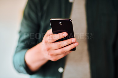 Buy stock photo Cropped shot of unrecognizable man using a cellphone indoors