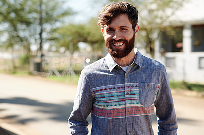 Buy stock photo Cropped shot of a happy young man walking outside
