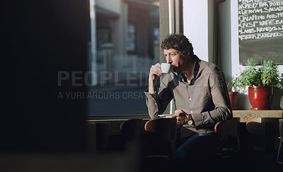 Buy stock photo Cropped shot of a man having coffee