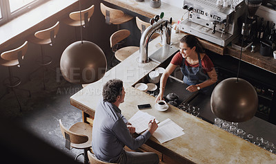 Buy stock photo Shot of a female barista serving a customer