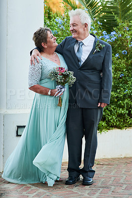 Buy stock photo Full length shot of a happy senior couple posing together outdoors on their wedding day