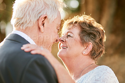 Buy stock photo Shot of a happy senior couple dancing and enjoying themselves outdoors on their wedding day