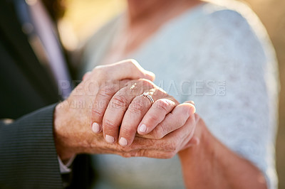 Buy stock photo Cropped shot of an unrecognizable senior couple dancing and enjoying themselves outdoors on their wedding day