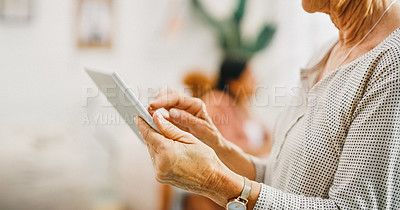 Buy stock photo Cropped shot of a senior businesswoman using a digital tablet in a modern office