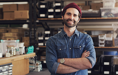 Buy stock photo Portrait of a confident young businessman working in a creative office
