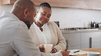 Buy stock photo Cropped shot of a happy senior woman sitting with her financial advisor in her home during the day