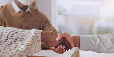 Buy stock photo Cropped shot of an unrecognizable woman sitting and shaking hands with her financial advisor after a successful meeting at home