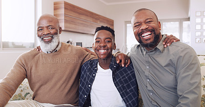 Buy stock photo Cropped portrait of a young boy sitting on the sofa and bonding with his father and grandfather