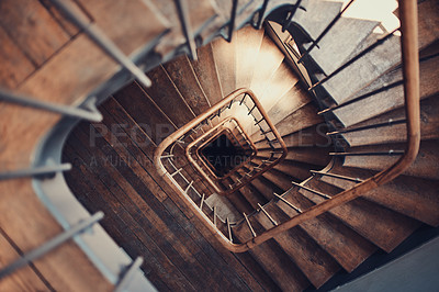 Buy stock photo High angle shot of a spiral staircase