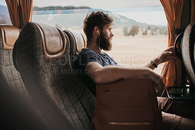 Buy stock photo Cropped shot of a man wearing earphones while sitting on the bus
