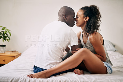 Buy stock photo Full length shot of an affectionate young couple sharing an intimate moment in their bedroom at home