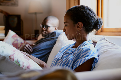 Buy stock photo Cropped shot of a young couple sitting on the sofa together during a day off at home