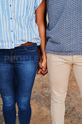 Buy stock photo Cropped shot of an unrecognizable couple standing together and holding hands during a day out