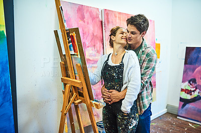 Buy stock photo Cropped shot of an affectionate young woman sharing a romantic moment with her boyfriend while painting in an art studio