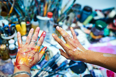 Buy stock photo Cropped shot of an unrecognizable female painter's paint-covered hands in an art studio