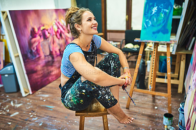 Buy stock photo Full length shot of an attractive young female painter admiring her canvas painting in her art studio
