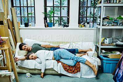 Buy stock photo Full length shot of an affectionate young couple sleeping on a sofa together at home