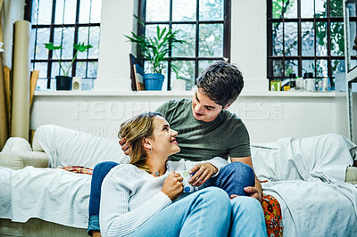 Buy stock photo Cropped shot of an affectionate young couple bonding and spending time together at home