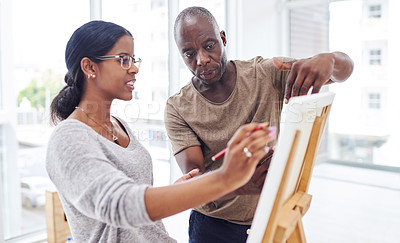 Buy stock photo Cropped shot of a woman talking to her teacher in a art class