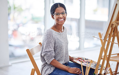 Buy stock photo Cropped shot of a beautiful young woman smiling at the camera in a art studio