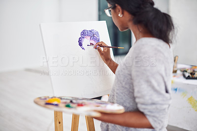Buy stock photo Cropped shot of a beautiful young woman painting in a art studio