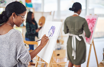 Buy stock photo Defocused shot of a group of people painting in a art studio