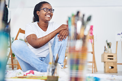 Buy stock photo Cropped shot of a happy young woman sitting in a art studio