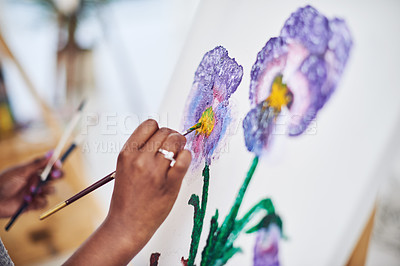 Buy stock photo Cropped shot of an unrecognizable woman working on a painting in a art studio