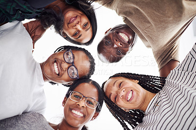 Buy stock photo Cropped shot of a group of people looking down at the camera