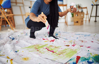 Buy stock photo Cropped shot of an unrecognizable woman painting in a art studio