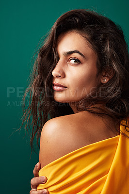 Buy stock photo Shot of a beautiful young woman posing against a green background