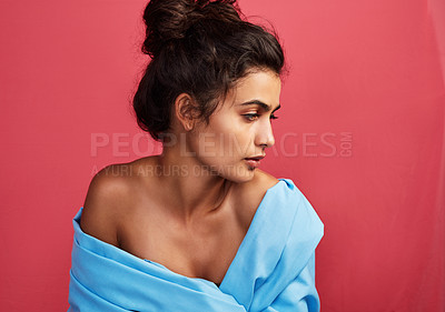 Buy stock photo Shot of a beautiful young woman posing against a red background
