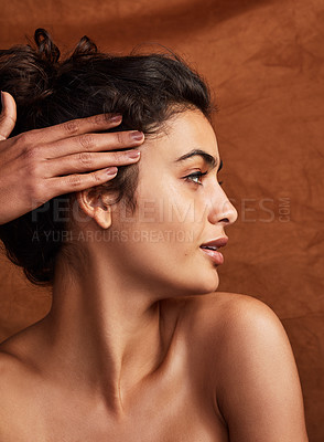 Buy stock photo Shot of a beautiful young woman posing against a brown background