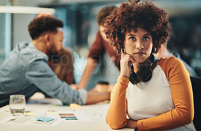 Buy stock photo Cropped portrait of an attractive young businesswoman looking serious while sitting in the boardroom during a meeting
