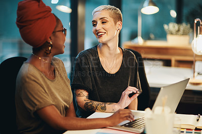 Buy stock photo Cropped shot of two attractive young businesswoman working together in their office
