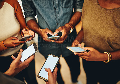 Buy stock photo High angle shot of a group of unrecognizable businesspeople standing in a circle with their cellphones in the office