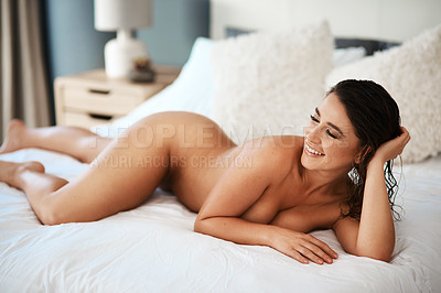 Buy stock photo Cropped shot of a sexy young woman posing nude in her bedroom