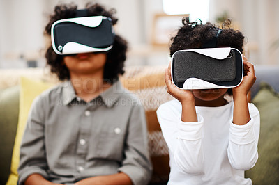Buy stock photo Cropped shot of two little boys watching movies together through virtual reality headsets at home