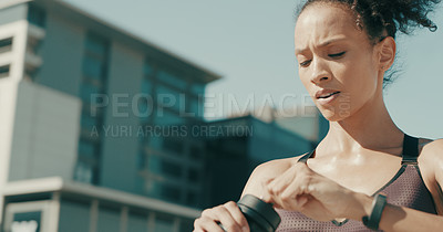 Buy stock photo Shot of a sporty young woman taking a break while exercising in the city